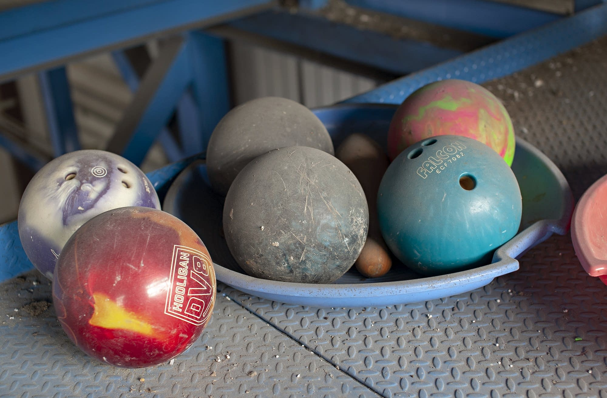 Bowling balls await disposal.