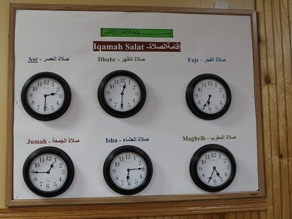 A wall with six clocks on a wall