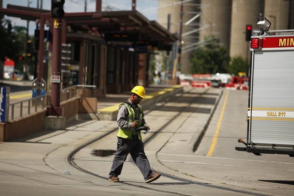 Police evacuate the area after a construction equipment struck a gas main.