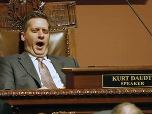House Speaker Kurt Daudt yawns as he waits for the roll call.