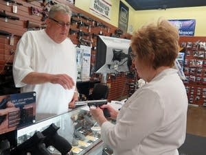 Sandy Bartholomew shops for a handgun in Osseo.
