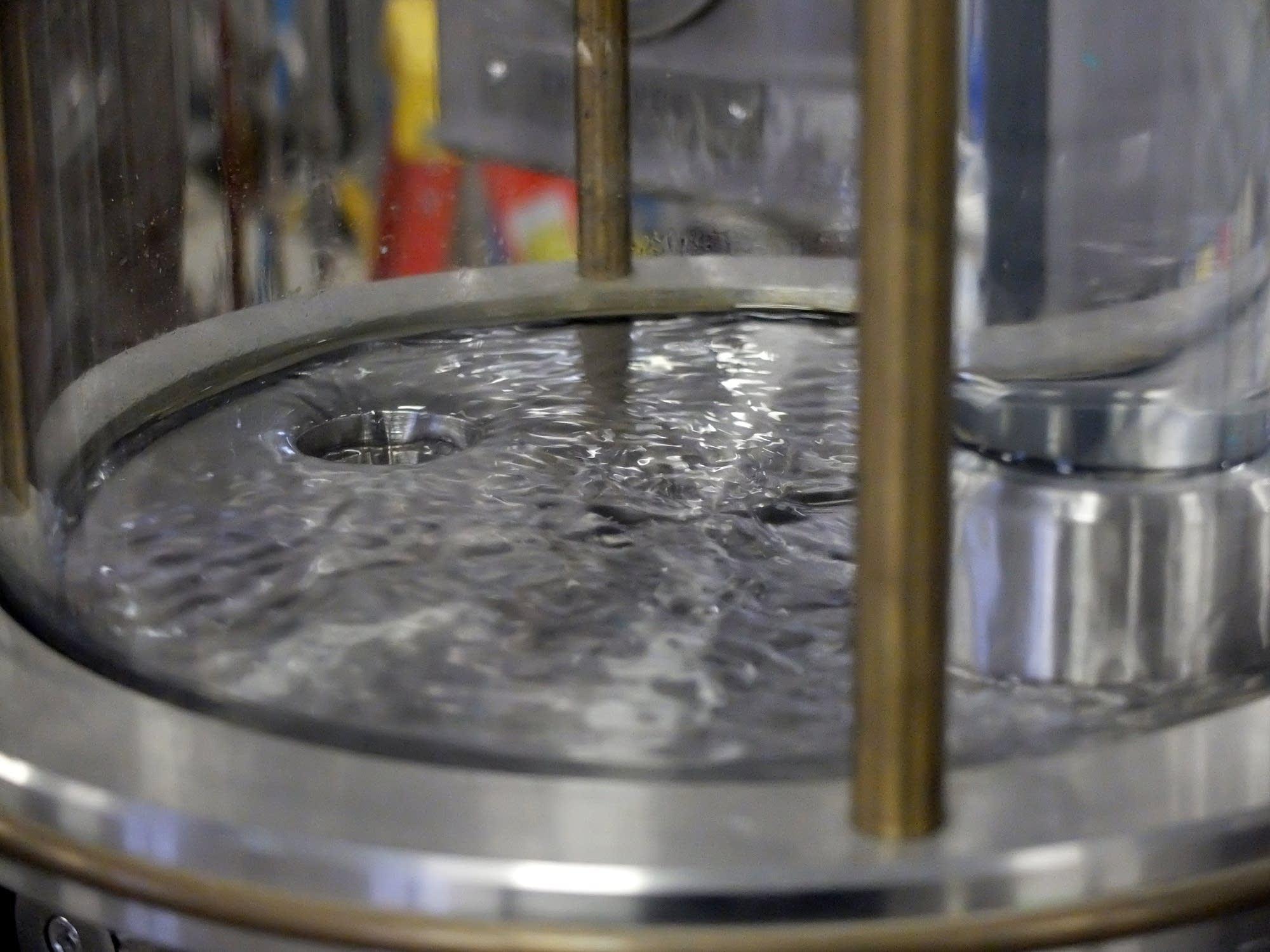 Distillate flows from a still at Far North Spirits.
