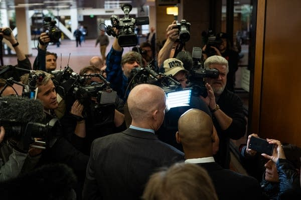 Mohamed Noor and his attorneys are surrounded by media.