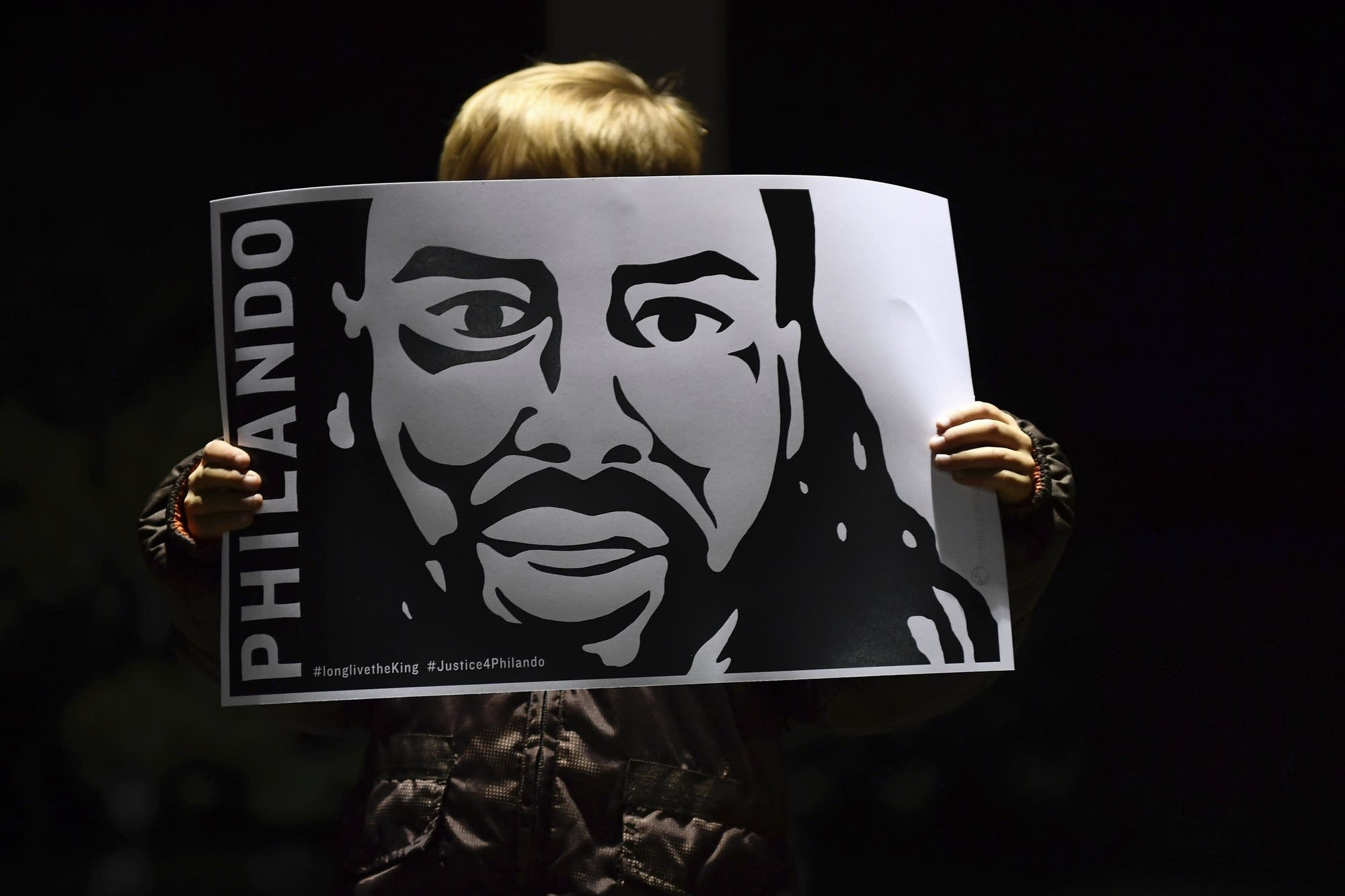 Judah O'Hara holds an image of Philando Castile.