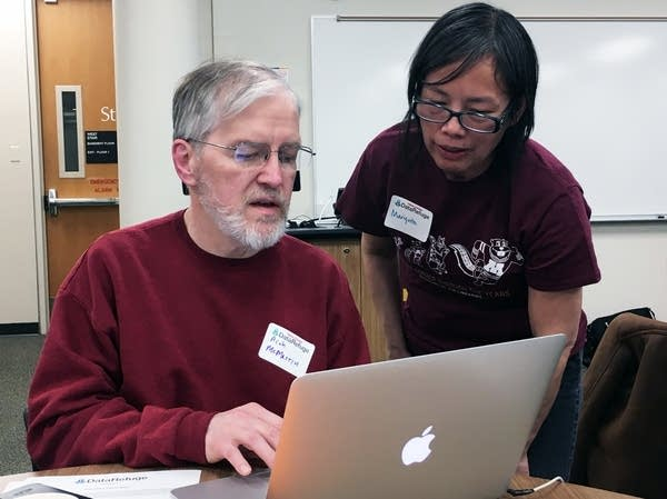 Rich McMartin and Mariquita Anderson work on saving research data