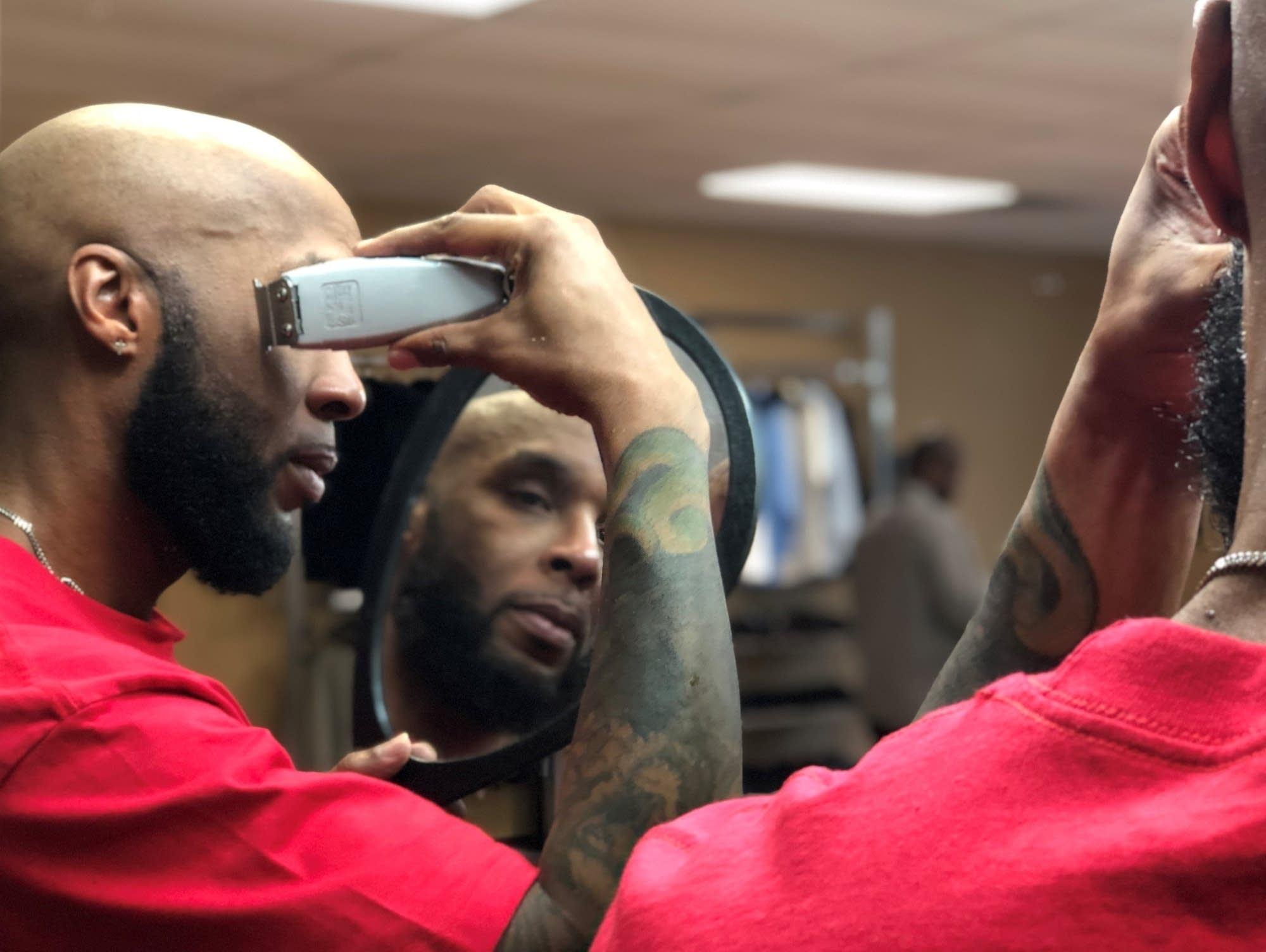 Gilbert Jordan is the lead barber at Barbershop Social Services