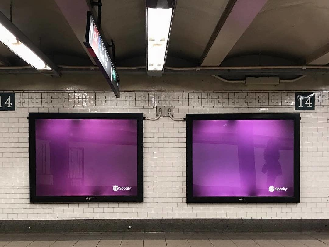 Purple Spotify ads in the New York subway