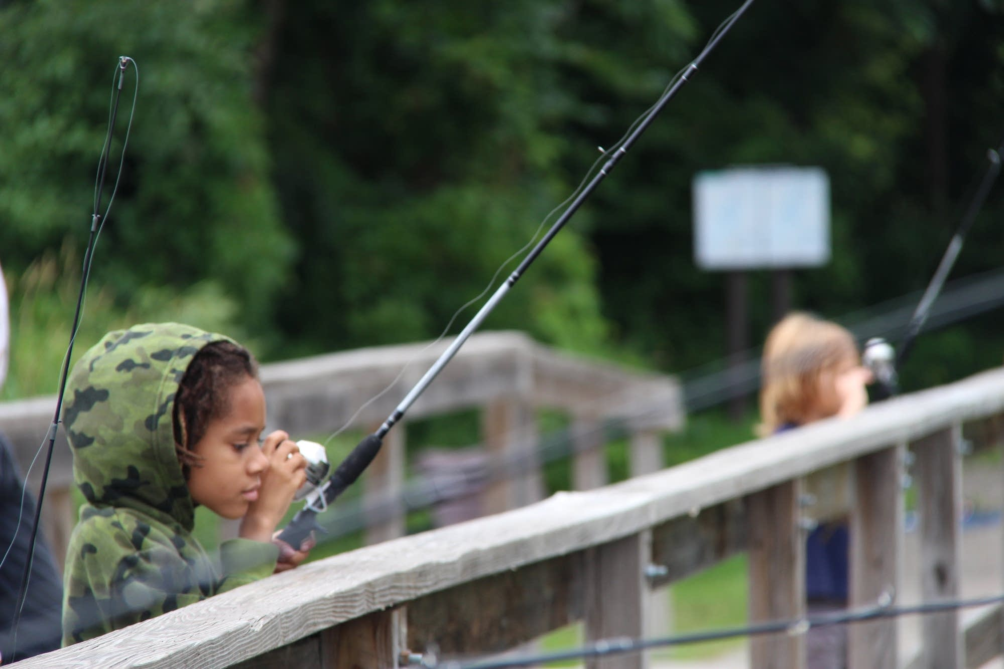 Amitri Hosea watches his line after casting into Snelling Lake.