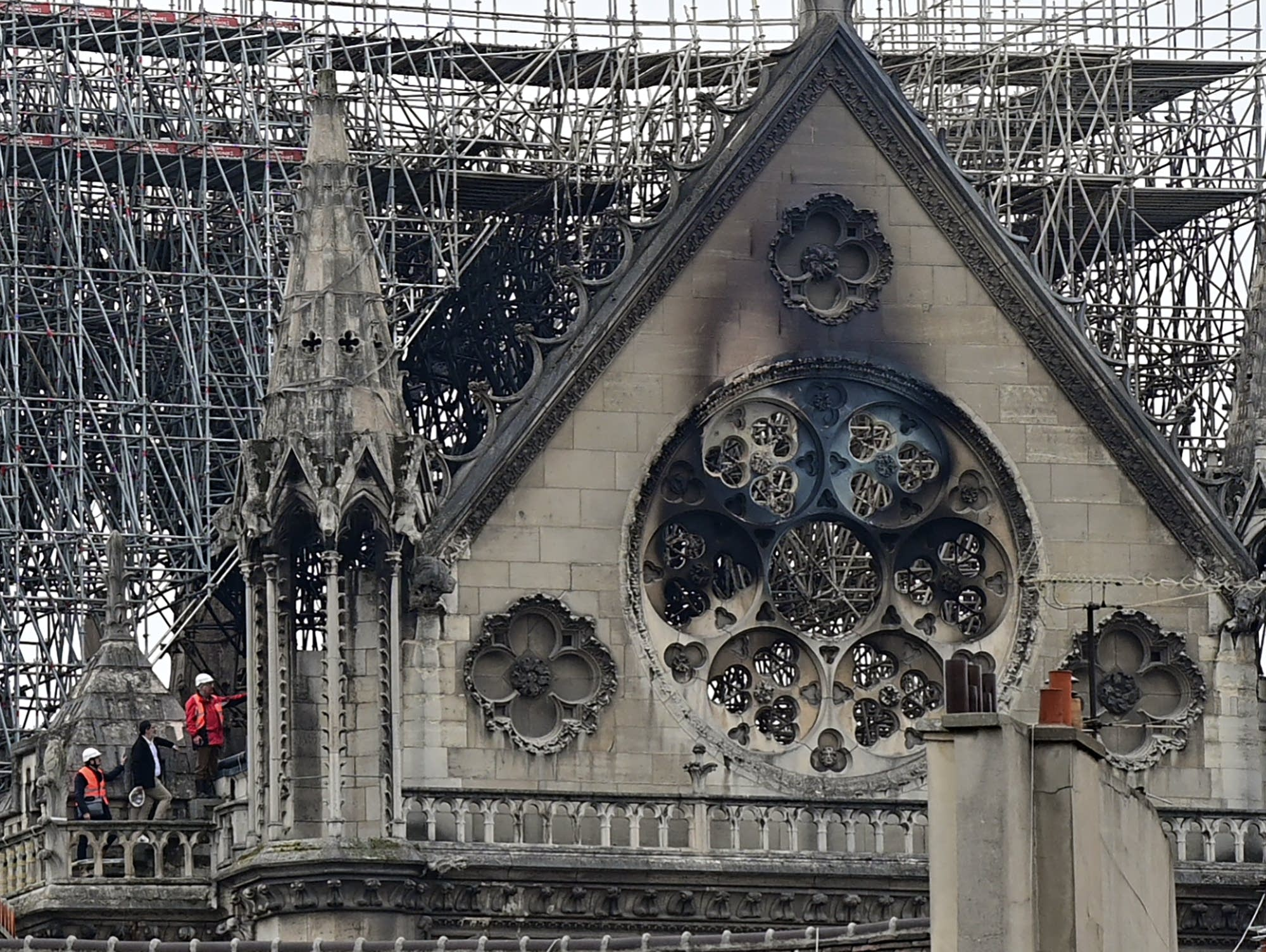 Inspectors are seen on the roof of Notre Dame in Paris on April 16.