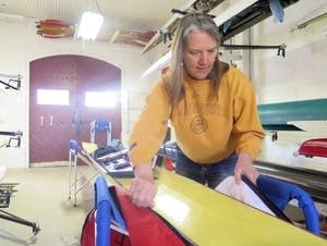 Jacqueline Hamilton works on her row boat at the Minnesota Boat Club.