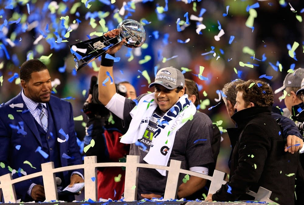Russell Wilson Of The Seattle Seahawks Celebrates With Vince Lombardi Trophy After Defeating Denver Broncos 43 8 In Super Bowl XLVIII At MetLife