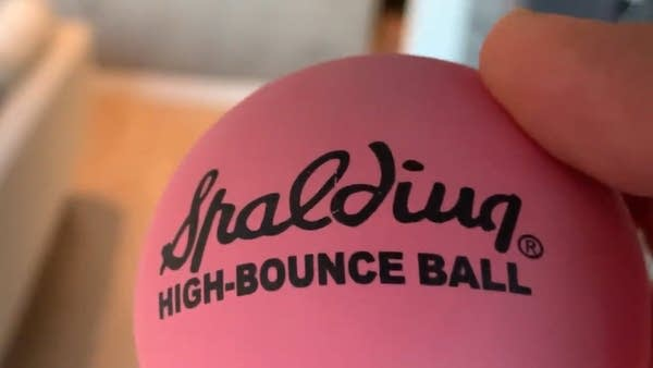 "Extreme closeup of a pink ""Spalding High Bounce Ball"""