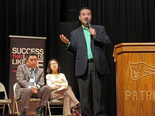 Wa Houa Khang talks to students at Patrick Henry High School.