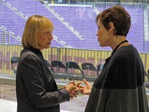 Michele Kelm-Helgen talks to her successor, interim chair Kathleen Blatz.