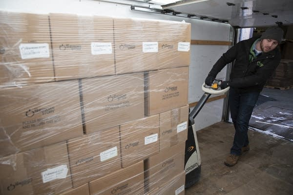 Rob Williams loads a truck with non-perishable food at The Sheridan Story.