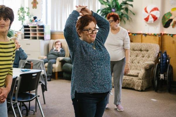 Pauline dances along to a video.