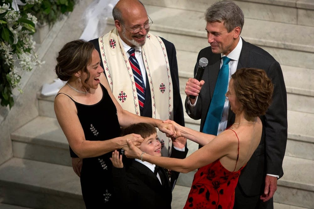 Couples celebrate same-sex marriage in midnight ceremonies