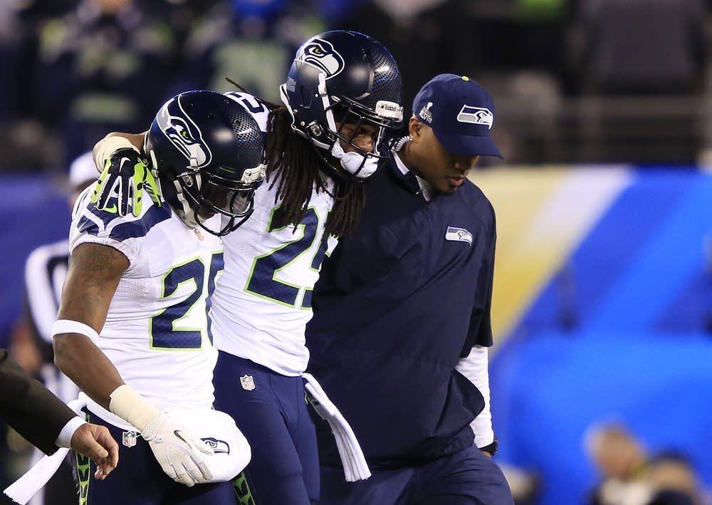 Richard Sherman helped from the field