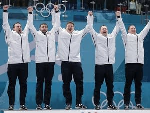 The U.S. men's curling team wins gold.