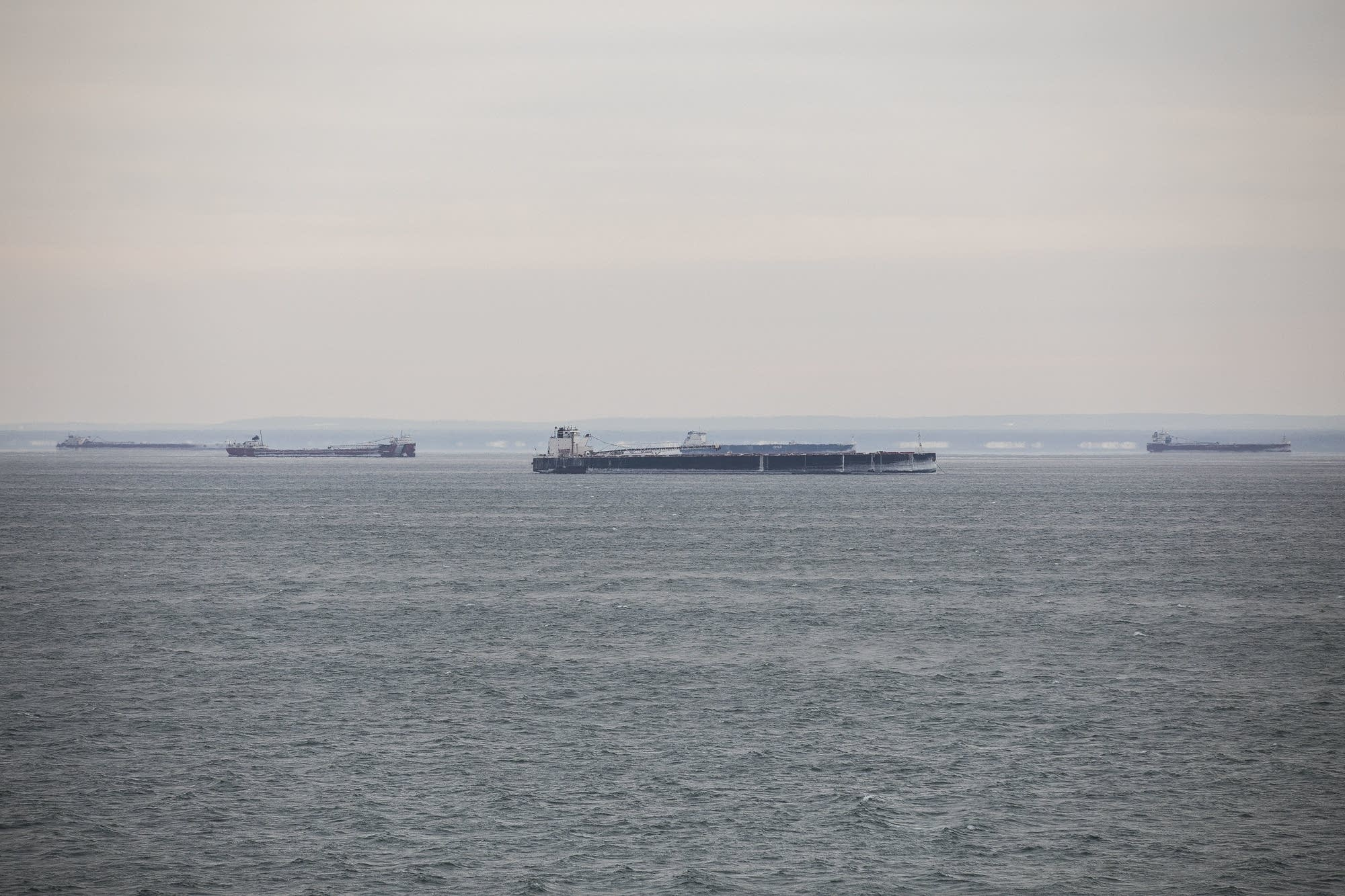 The ships are anchored offshore from Duluth for a variety of reasons.