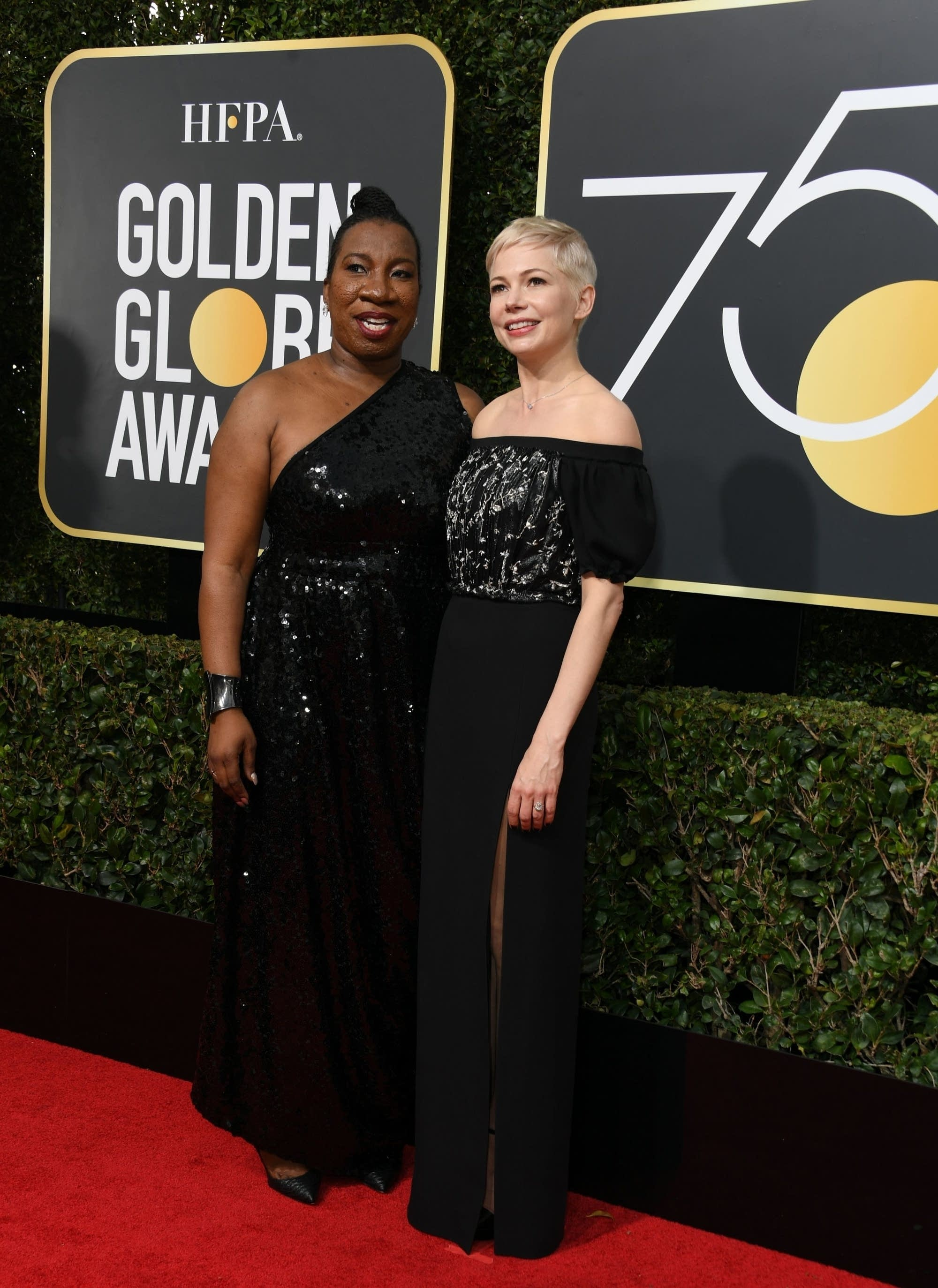 Michelle Williams and Burke arrive at the Golden Globes.