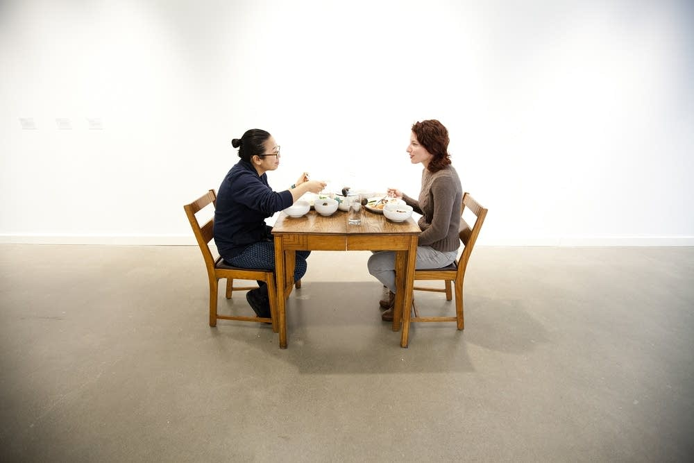 Strangers dining -- as art.