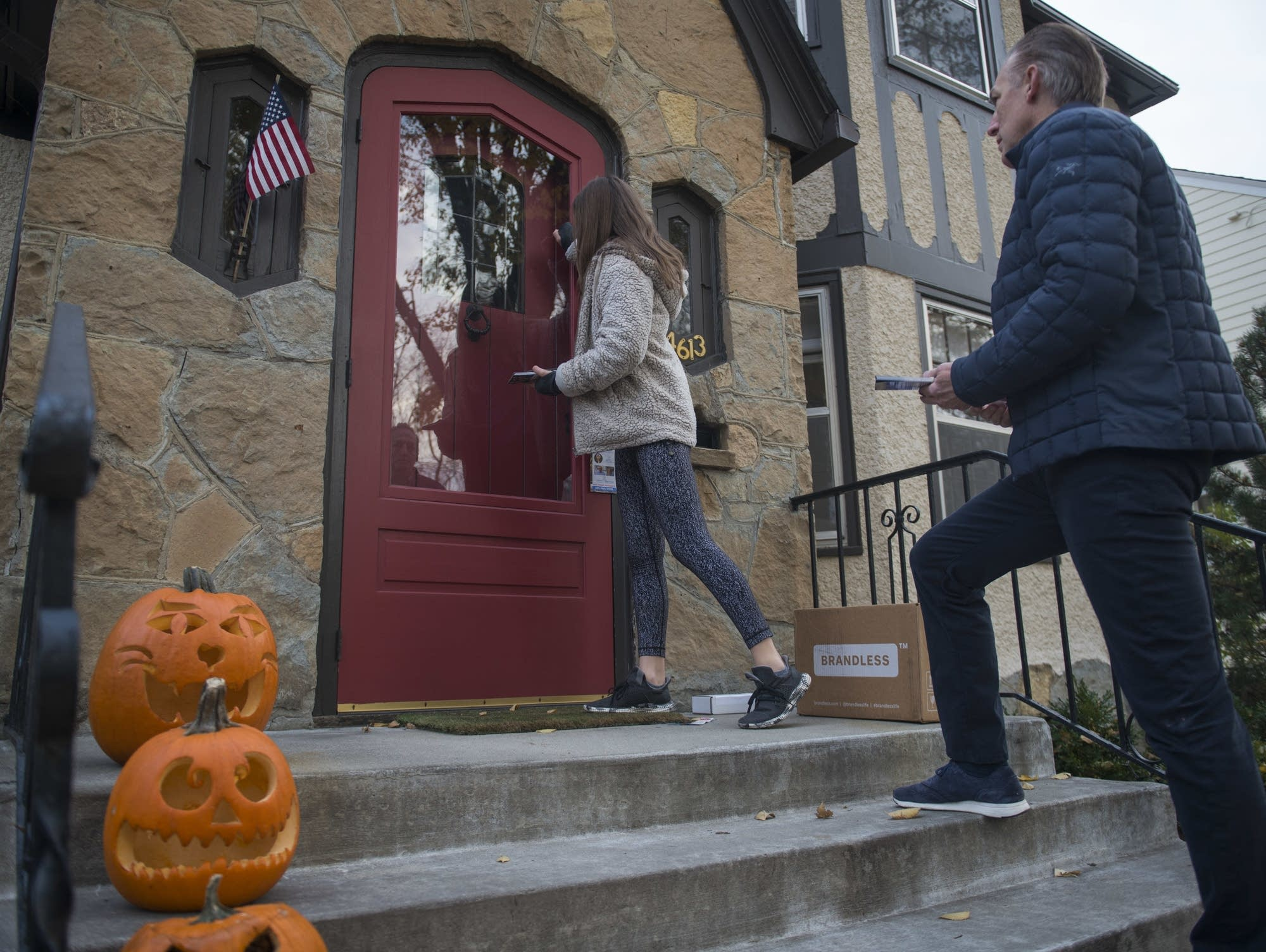 Dario Anselmo's daughter Ali knocks on a door in Edina
