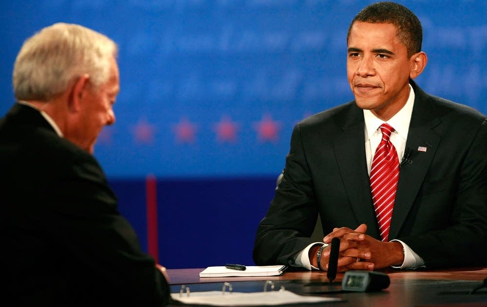 Barack Obama takes his seat at the debate