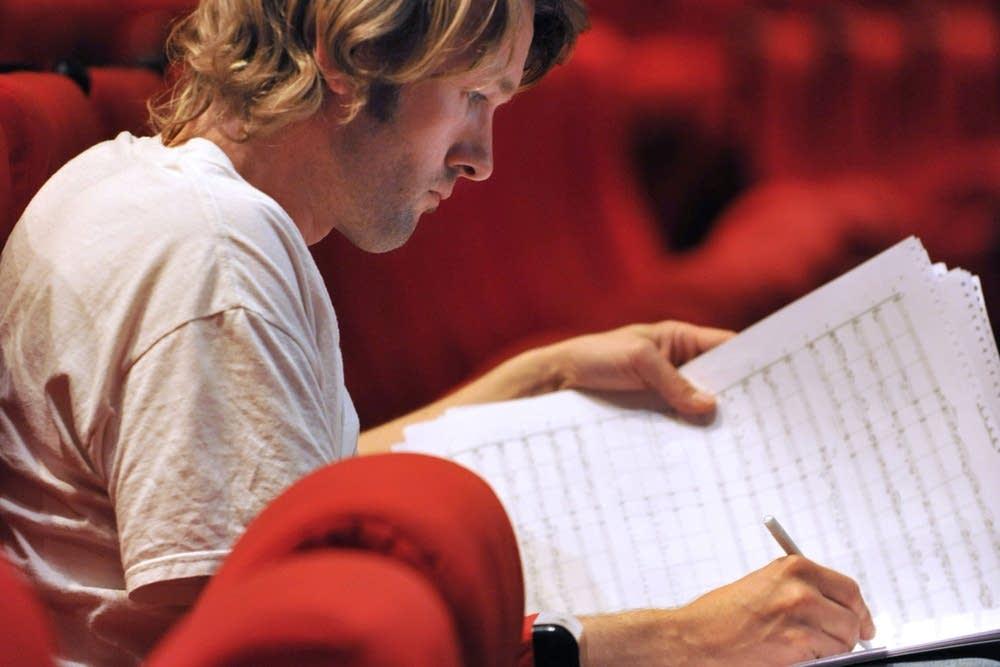 Composer Gabriel Prokofiev works on sheet music