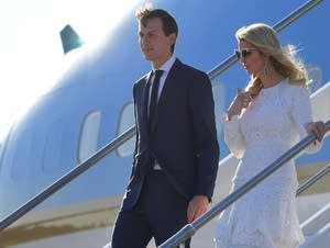 Ivanka Trump and Jared Kushner step off Air Force One.