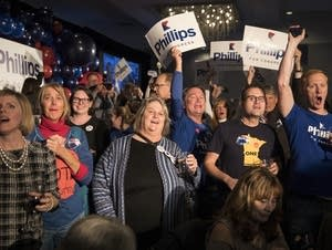 Phillips' supporters cheer his win.