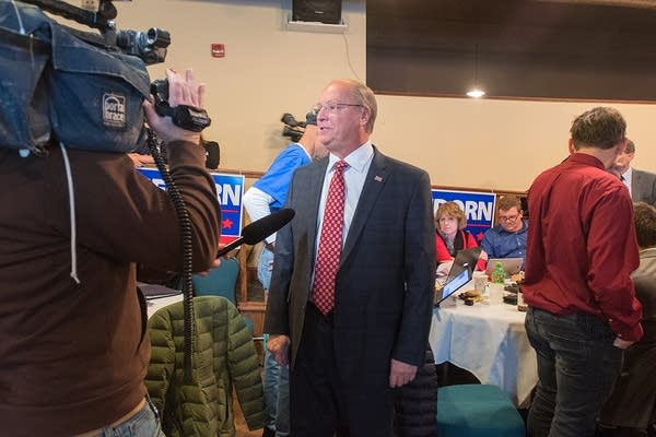 Jim Hagedorn speaks to a television reporter at the election party.