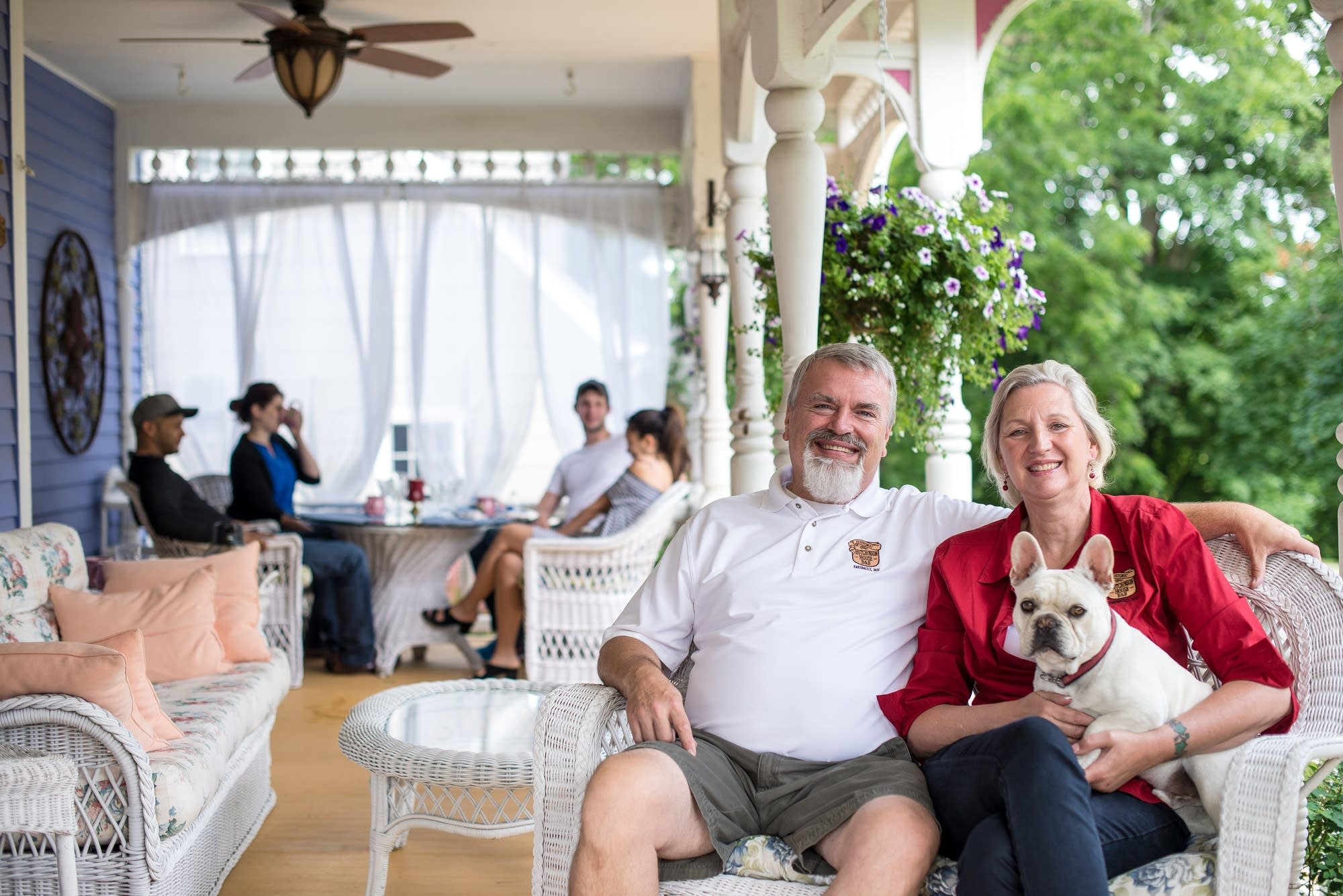 Doug and Tami Schluter on the porch of their bed and breakfast