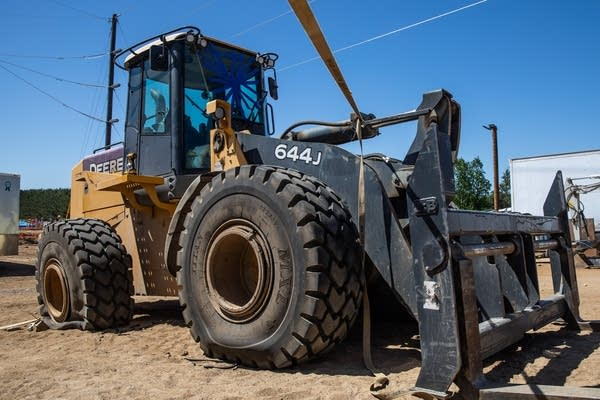A forklift with flat tires.