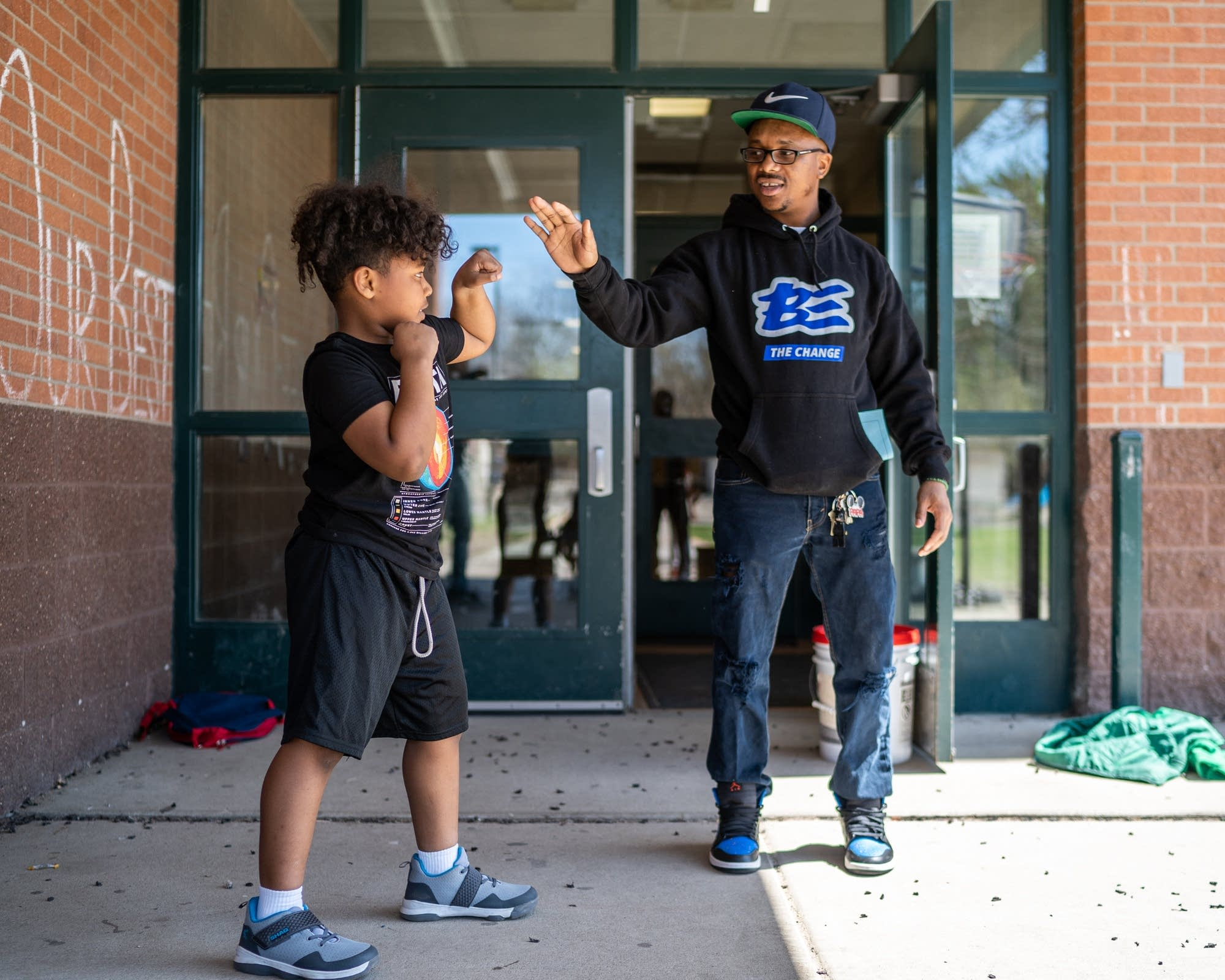 Morgan McDonald Sr. does boxing drills with 8-year-old Mekhi.