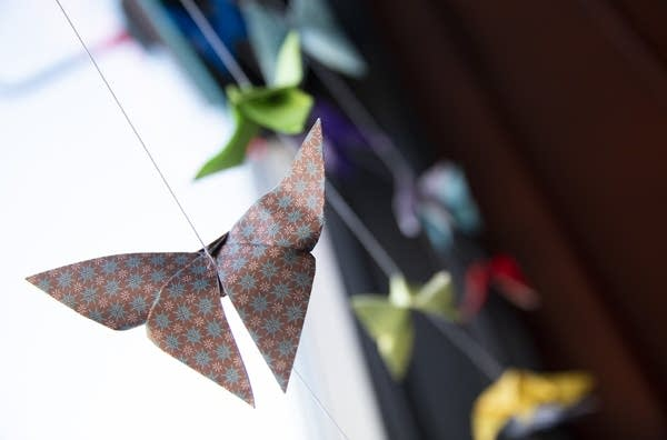 Origami butterflies hang in the window at Cafe Steam in Rochester, Minn.