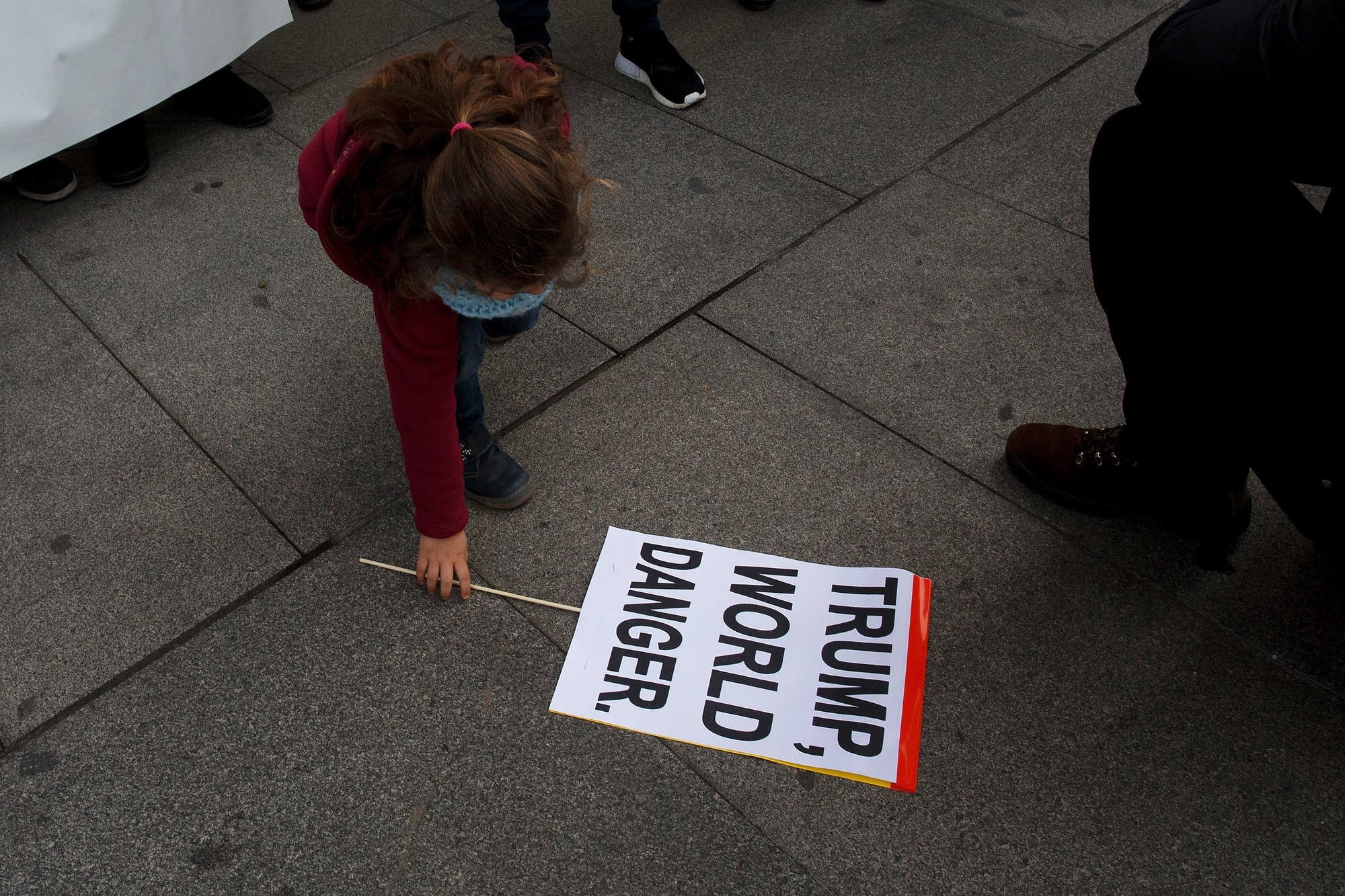 Madrid, Spain: A girl picks up a placard.