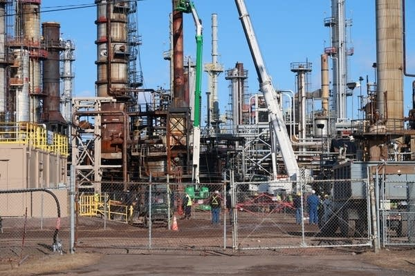 An oil refinery undergoing clean-up efforts.