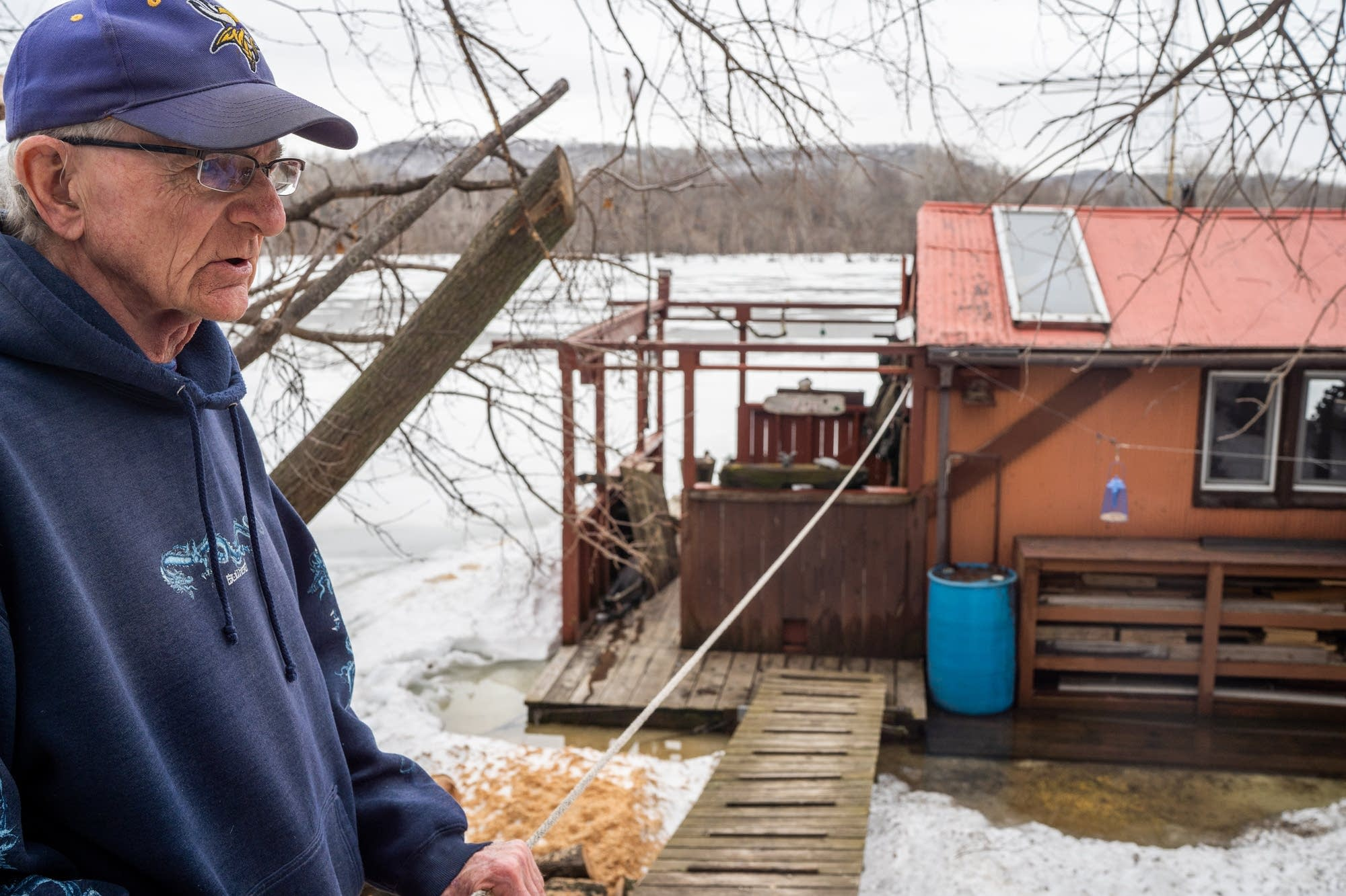 John Rupkey stands in front of his houseboat.