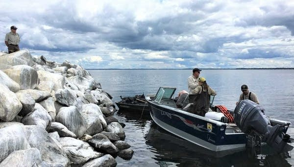 Crews clean up trash from islands in Mille Lacs Lake.