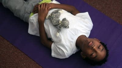 Yoga and dogs bring calm to school for troubled kids