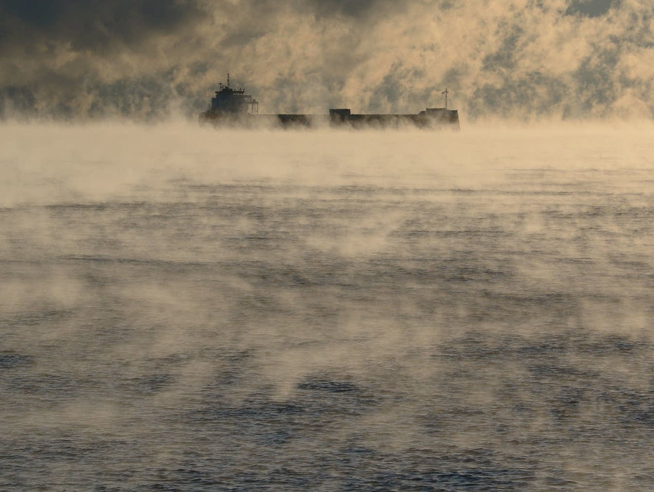 The saltie Reestborg is anchored on Lake Superior amid sea smoke.