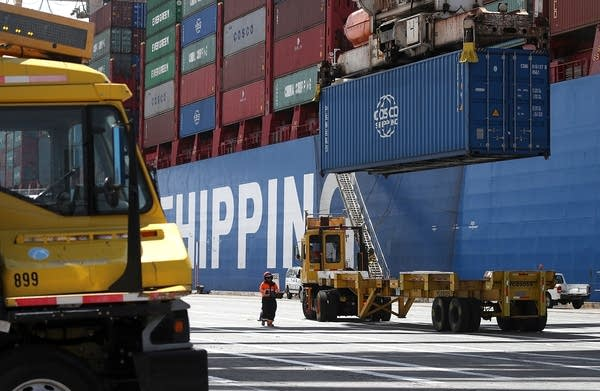 A container is being unloaded in the port of Oakland.