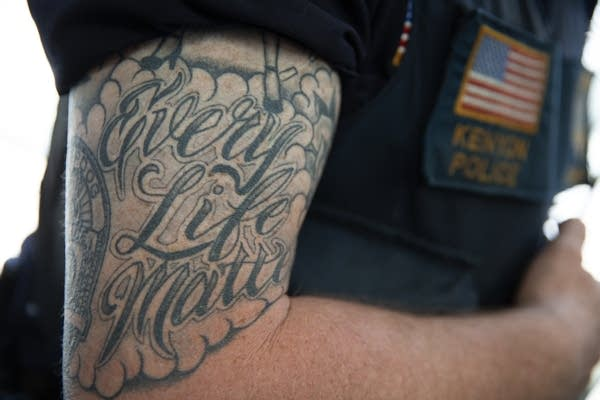 "A tattoo on Lee Sjolander's arm reads ""Every Life Matters."""