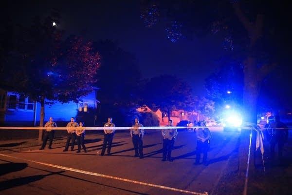 Police guard the scene near the corner of 48th Avenue North and Camden Ave.