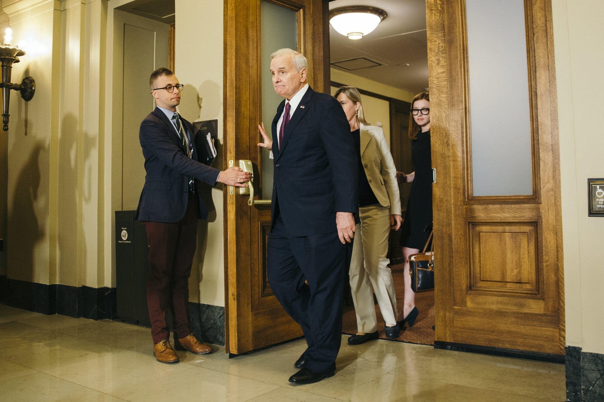 DFL Gov. Mark Dayton leaves the Cabinet Room.