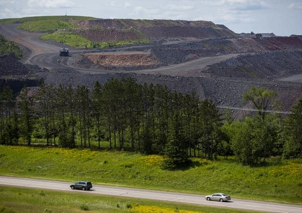 Vehicles head south on Hwy. 53 next to the mine.