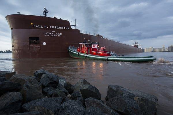 Tugboats work on the Paul R. Tregurtha