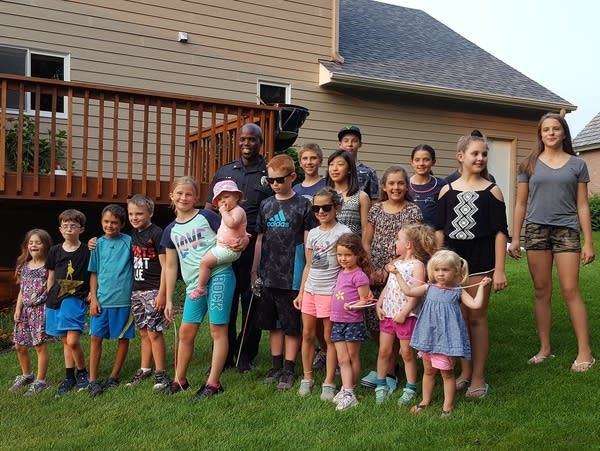 Kids gather with now-Eagan Police Chief Roger New at National Night Out