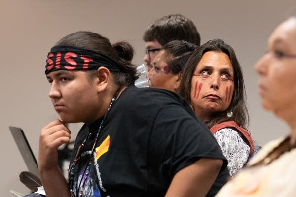 Youth climate intervener Nolan Berglund and activist Winona LaDuke.